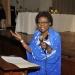 mini-Dr. Daisy Kabagarama reading her poem