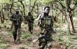 Ugandan soldiers, tasked with tracking down Joseph Kony's Lord's Resistance Army, walk in a forest bordering the Central African Republic. (Reuters/Justin Dralaze )