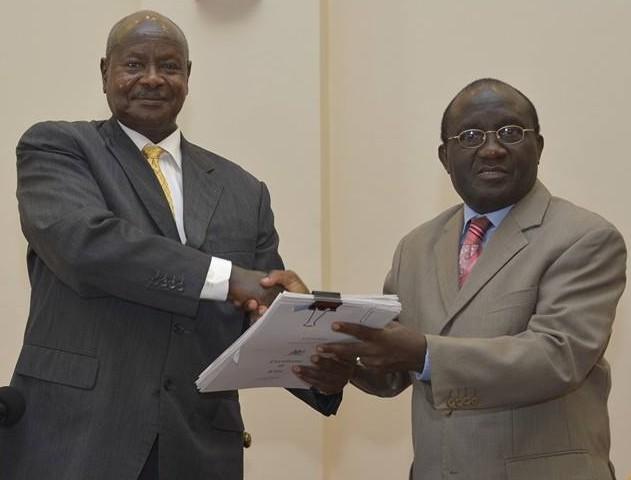 President Museveni handing over titles to Buganda's first Deputy Katikkiro Ambassador Emmanuel Ssendaula