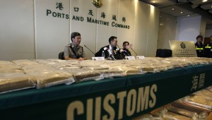 John Lee, head of Customs Drug Investigation Bureau, speaks in front of packs of cocaine seized in Hong Kong