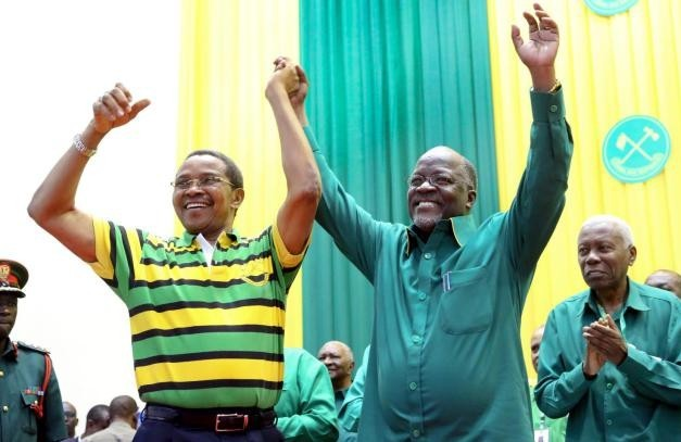 Tanzania's public works minister John Pombe Magufuli, right, celebrates with president Jakaya Kikwete, left, after the ruling party announced its presidential candidate, in Dodoma, Tanzania, Sunday, July 12, 2015