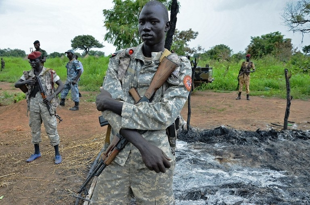 "TOPSHOTS South Sudanese SPLA soldiers are pictured in Pageri in Eastern Equatoria state on August 20, 2015. The spokesman of SPLA, Colonel Philip Aguer visited the area after the government claimed to be back in control of the area following an attack by rebel forces. South Sudan's civil war began in December 2013 when Kiir accused his former deputy Riek Machar of plotting a coup, setting off a cycle of retaliatory killings that has split the poverty-stricken country along ethnic lines. The government says they will return to talks in Ethiopia in early September to ""finalise"" a peace deal. AFP PHOTO / SAMIR BOL"