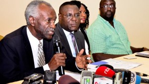 The chairman of The Elders Forum Uganda, Justice James Ogoola (L) addresses Journalists during a press conference by the Inter Religious Council at Imperial Royale Hotel on Wednesday. Next to him is the Council's Secretary General, Joshua Kitakule, debate moderators, Nancy Kacungira and Alan Kassujja in that order. PHOTO BY ERIC DOMINIC BUKENYA