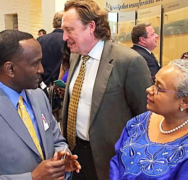 Benson Kioko East African Chamber of Commerce EACC) Board member chats with Kenya's First Last Lady at the Reception.