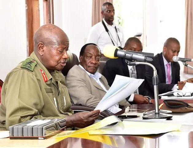 President Museveni with Electoral Commission chairman Badru Kiggundu and other EC officials at Bombo yesterday