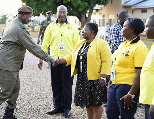 President Museveni greets NRM Secretary General Kasule Lumumba and other party officials on arrival at Kyankwanzi