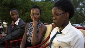 Lupita Nyong'o looks on as Phiona Mutesi the star of the new movie - The Queen of Katwe makes her point.