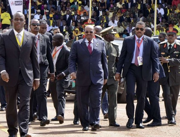 President Omar al-Bashir of Sudan, center, arrives for the inauguration ceremony of President Museveni May 12th 2016