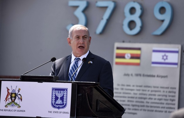 Israeli Prime minister Benjamin Netanyahu, gives a speech after his arrival at Entebbe airport Uganda, Monday, July 4, 2016. Netanyahu is on a four-nation Africa tour to Uganda, Kenya, Rwanda and Ethiopia. (AP Photo/Stephen Wandera)