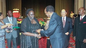 UNAA Philadelphia Convention featuring a handshake between UNAA BOT member and the then Ugandan Ambassador to the USA.