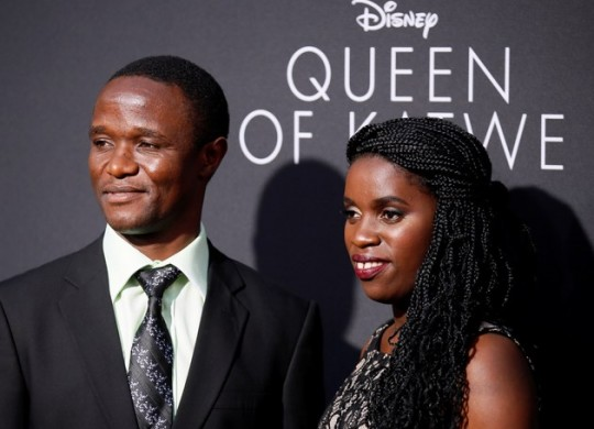 "ROBERT KATENDE (L) AND UGANDAN CHESS PLAYER PHIONA MUTESI (R), WHO ARE PORTRAYED IN ""QUEEN OF KATWE"" POSE AT THE FILM'S LOS ANGELES PREMIERE IN HOLLYWOOD, CALIFORNIA, SEPTEMBER 20, 2016. (REUTERS/DANNY MOLOSHOK)"