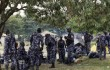 Ugandan soldiers gather in the town of Kasese on Nov. 28. Rights groups are urging Ugandan security forces to show restraint as they violently crack down on the members of a tribal militia in a remote area near the border with Congo. (Arne Gills/AP)