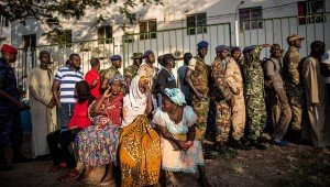 People waiting to vote in the presidential election outside a polling station in Banjul, Gambia, in December. Government officials said security concerns prompted internet services to be shut off and international cellphone calls to be blocked. MARCO LONGARI / AGENCE FRANCE-PRESSE — GETTY IMAGES