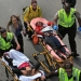 BOSTON - APRIL 15: (EDITOR\'S NOTE: THIS IMAGE CONTAINS GRAPHIC CONTENT) A person who was injured in an explosion near the finish line of the 117th Boston Marathon is taken away from the scene on a stretcher. (Photo by David L. Ryan/The Boston Globe via Getty Images)